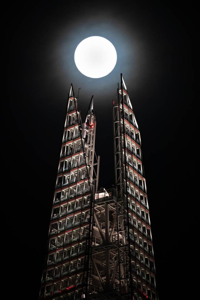 A super moon rises above the Shard