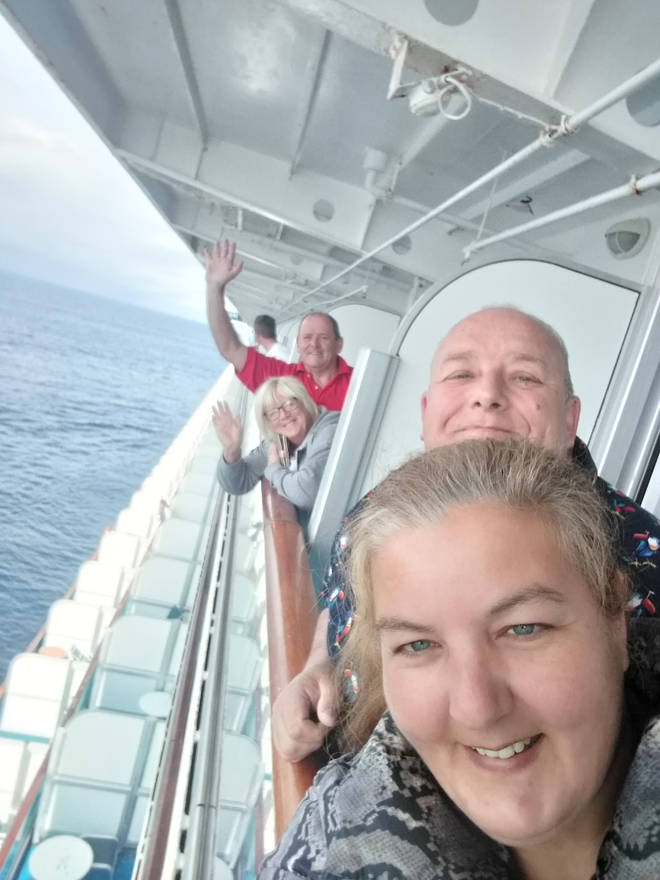 (Front to back) Justine and Dave Griffin, Sharon and Steve Lane from their balconies on the Grand Princess