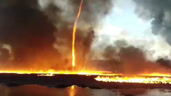 "The stunning ""firenado"" was captured by firefighters"