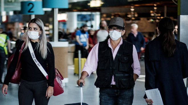 Tourists arriving at Lisbon airport with masks to protect themselves from COVID 19