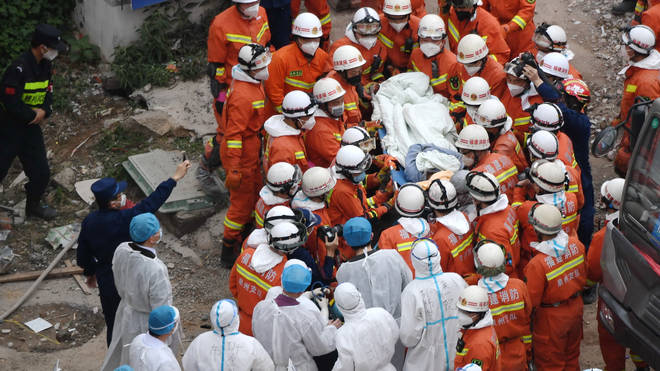 Rescue workers pull the man out after three days
