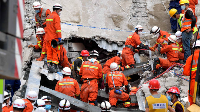 Rescue workers at the scene of the collapse