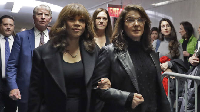 Accuser Annabella Sciorra, right, walks with friend Rosie Perez (left) as they arrived at the hearing