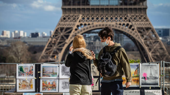 Tourists are seen on the Place du Trocadero in Paris