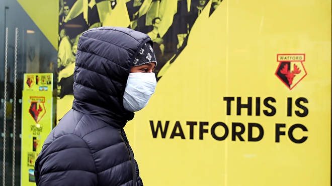 A youth wears a protective face mask on the weekend all Premier League matches are postponed