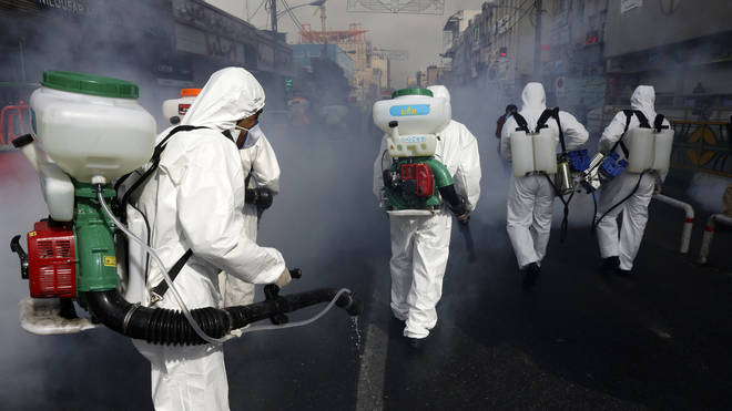 Firefighters have been spotted disinfecting streets in Tehran in recent weeks