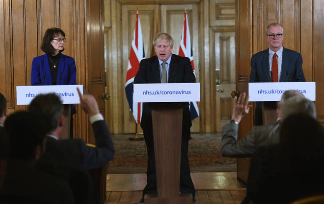 PM flanked by deputy chief medical officer and chief scientific adviser during the daily press conference