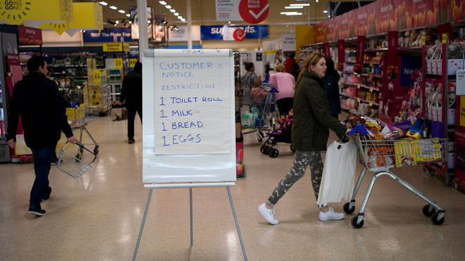 A board displays shopping restrictions at Tescos supermarket on March 19, 2020 in Warrington