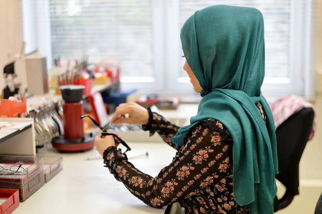 A woman wearing a hijab at work