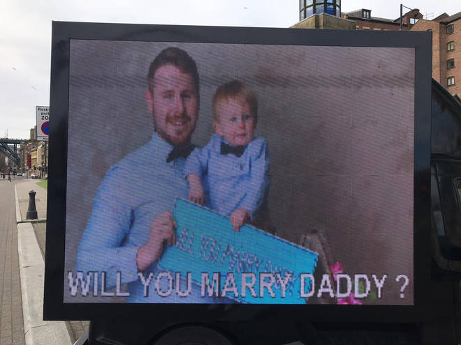 Jamie got a van with a picture of him and their son to propose