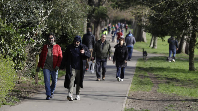 People were seen at parks and markets in London despite social distancing measures