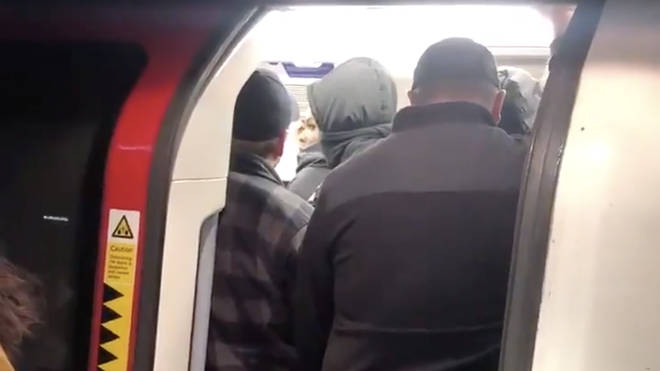 Tube trains were packed full despite the UK going into lockdown
