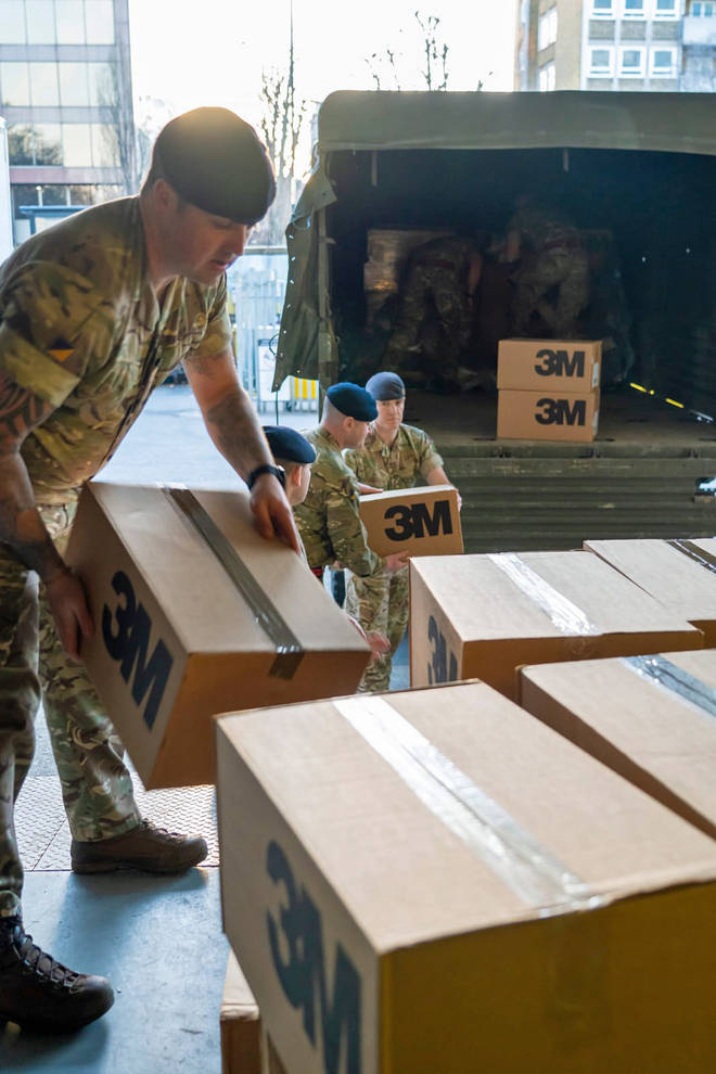 Soldiers unpack protective equipment