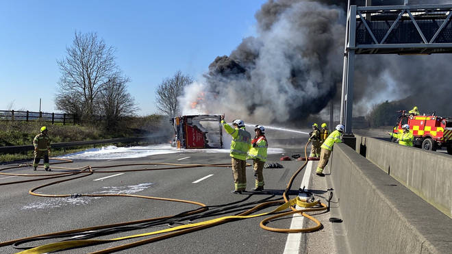 Thick smoke was seen billowing across the motorway as firefighters battled to control the blaze