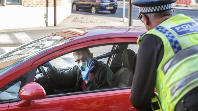 Police at a coronavirus checkpoint