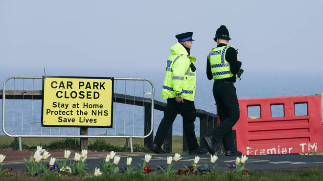 Police officers close a car park in Whitley Bay, Northumberland, as the UK continues in lockdown