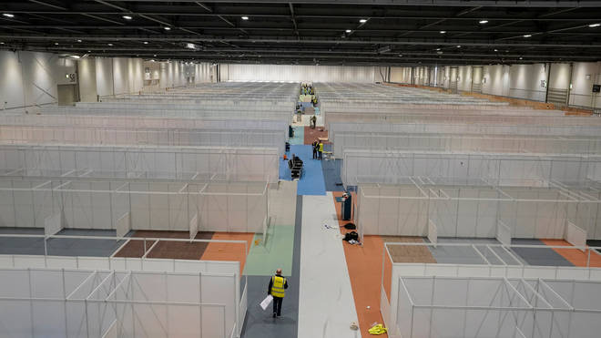 Hundreds of cubicles are being constructed inside the cavernous Docklands exhibition centre