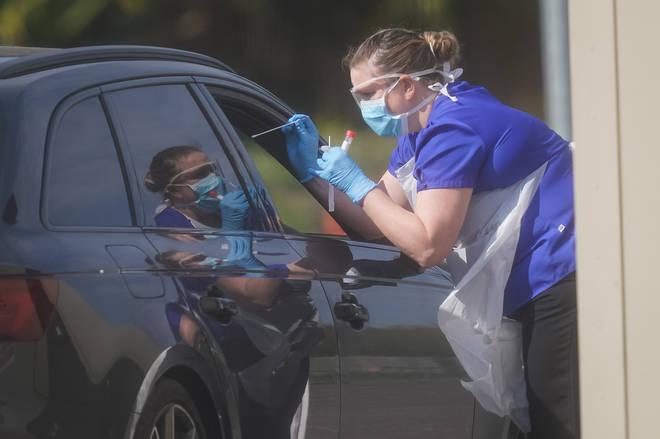 An NHS worker being tested for coronavirus at the car park of Chessington World of Adventures
