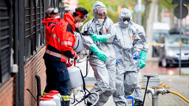 Members of the Barcelona Fire Brigade disinfect nursing home facilities