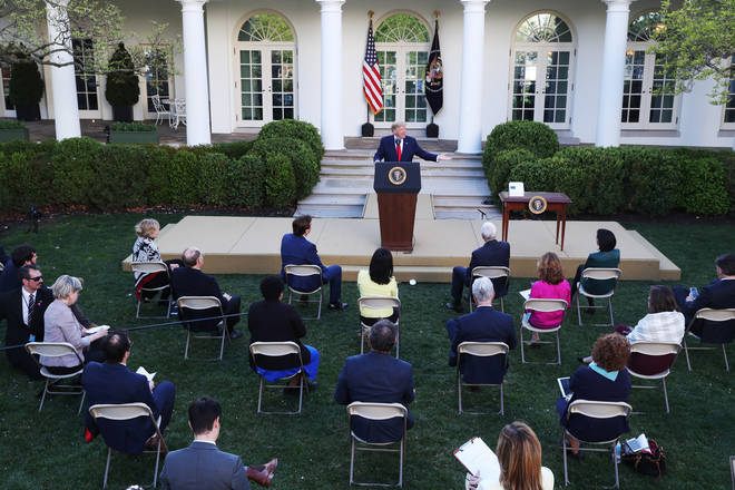 Mr Trump addressed reporters inside the Rose Garden at the White House