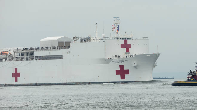 USNS Comfort Navy ship with 1000 beds to relief NYC hospitals on COVID-19 pandemic passes under Verrazzano-Narrows bridge