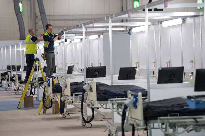 Row upon row of beds being made ready for incoming Covid-19 patients