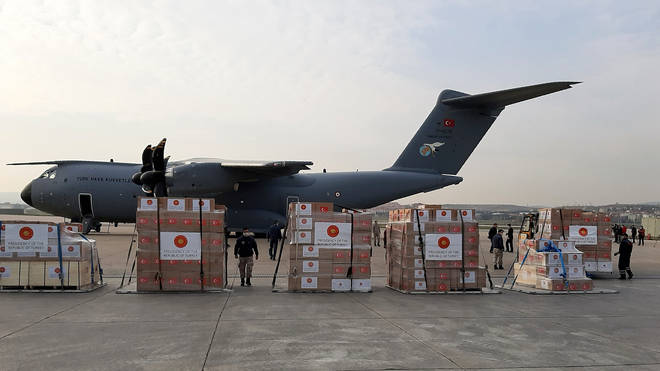 Soldiers in Turkey prepare to load a military cargo plane with Personal Protection Equipment heading to Italy and Spain