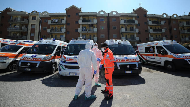 Red Cross staff wearing a protective containment suit sanitizes an ambulance that transported a Covid 19 patient in Baronissi, Italy