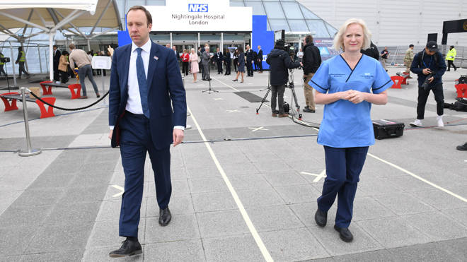 ealth Secretary Matt Hancock and Ruth May, chief nursing officer for England, at the opening of the NHS Nightingale Hospital at the ExCel centr