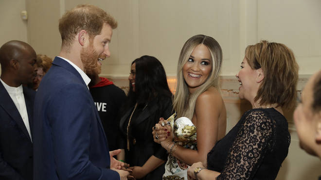 The pair pictured meeting Prince Harry together