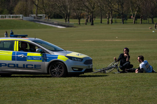 Police were clearing people from parks around the UK