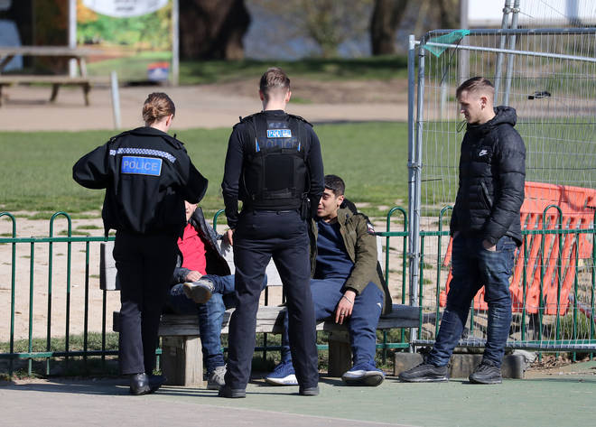 Police disperse a group of youngsters from a playground in Kent