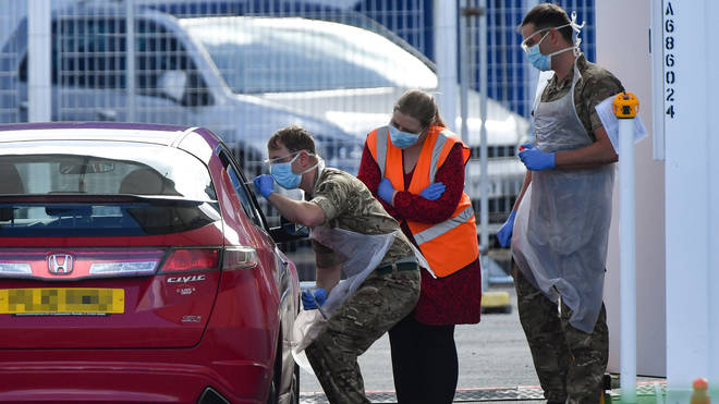 Military personnel help administer Covid19 tests for NHS workers at Edgbaston cricket ground in Birmingham