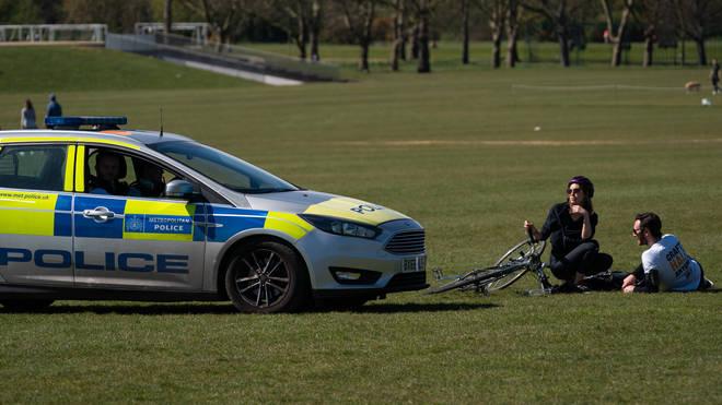 Police patrol Regent's Park in London during the lockdown