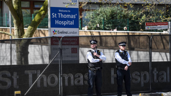 Police officers are seen outside St Thomas' Hospital on April 7, 2020
