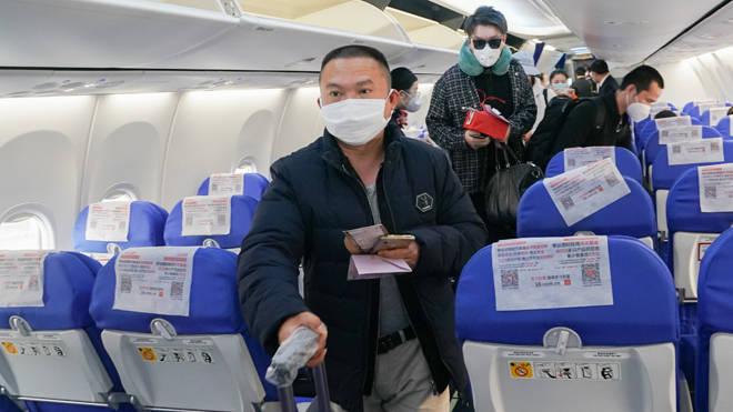 Passengers board flight MU2527 out of Wuhan