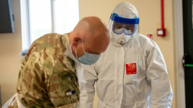 Members of the British Army learn how to apply PPE to support the Welsh Ambulance Service
