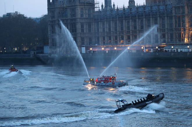 Members of the emergency services on the River Thames near St Thomas' Hospital in Westminster