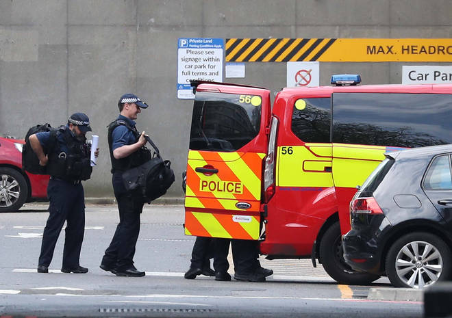 Police vans and other vehicles were seen leaving the hospital where Boris Johnson was being cared for