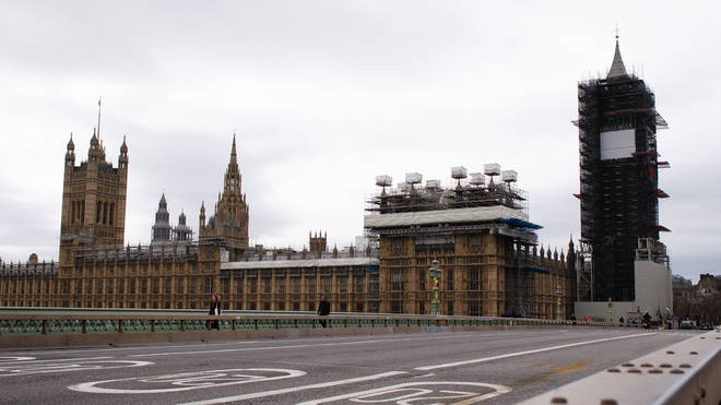 The Houses of Parliament overlook a deserted Westminster Bridge