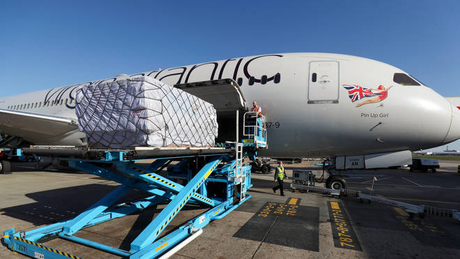 A Virgin Atlantic charter flight lands at Heathrow Airport, London, delivering vital medical supplies to UK from Shanghai