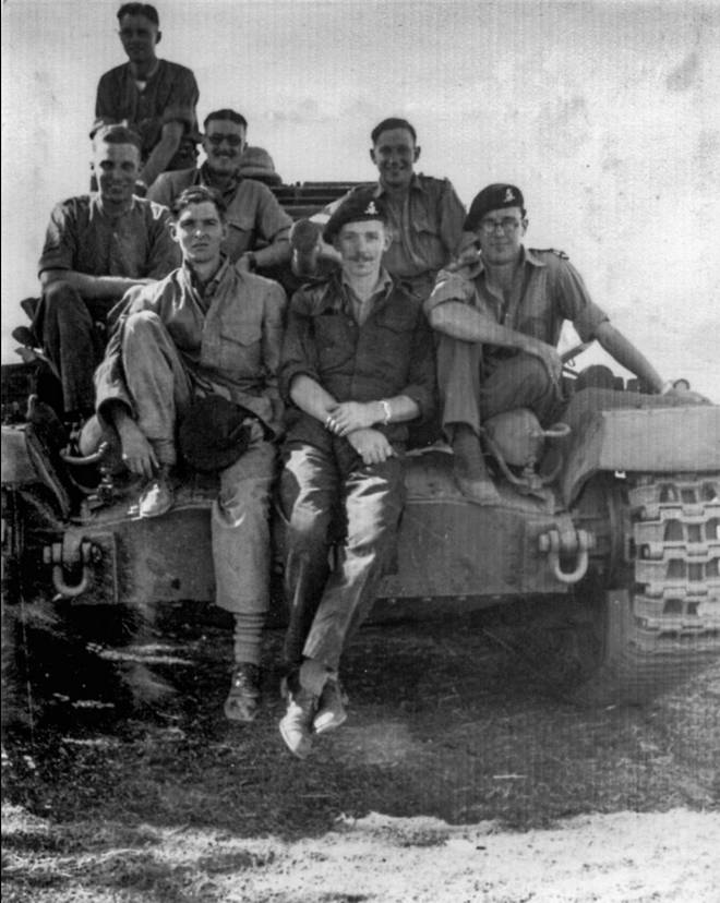 Mr Moore pictured centre during the war