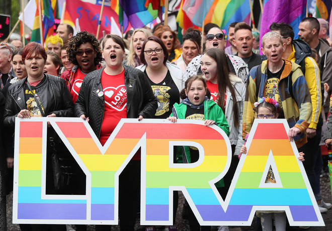 Sara Canning (front centre left), partner of murdered journalist Lyra McKee, marching with protesters through Belfast city centre demanding same sex marriage in Northern Ireland.