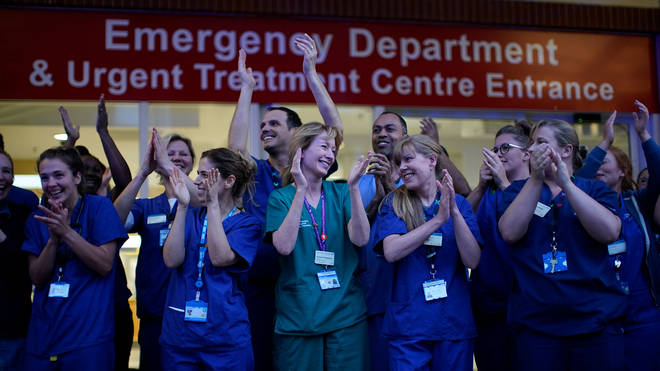 Nurses applaud each other outside Chelsea and Westminster Hospital