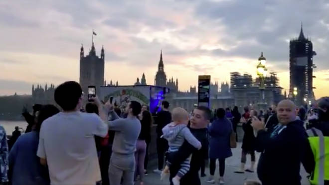 People gathered together on Westminster Bridge to clap for carers