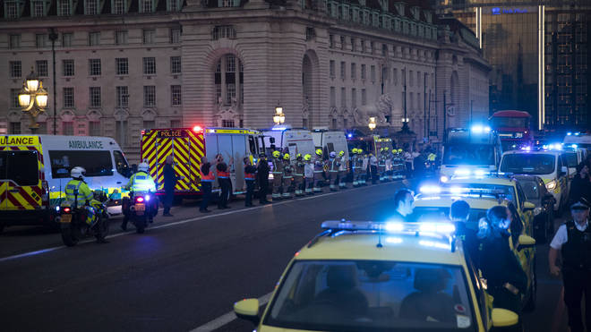 Emergency services lit up the London skyline with blue lights
