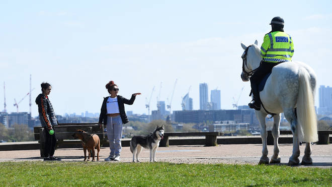 File photo: Mounted police officers speak to people on Primrose Hill, London, as the UK continues in lockdown