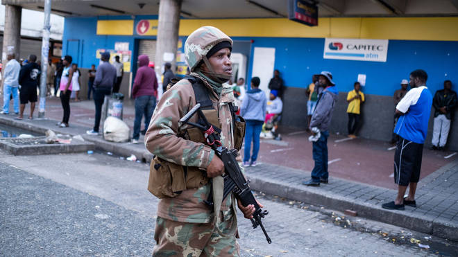 A soldier patrols the streets in Johannesburg to enforce a national lockdown
