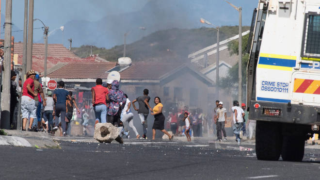 Residents of an impoverished suburb in Mitchells Plain, near Cape Town, clashed with authorities after some people did not receive food parcels