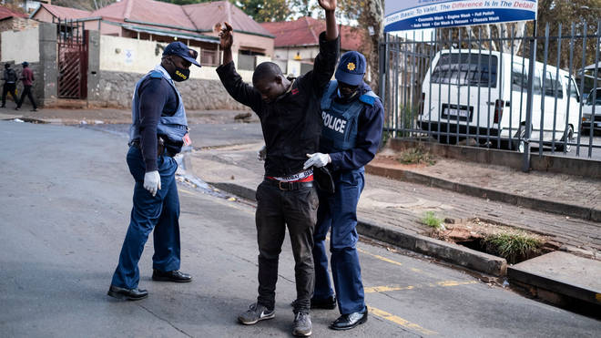 Police search one man in Johannesburg amid a strict lockdown